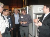 Eric Irmscher (r), sales and application engineer with Mestek, Inc., explains the standard arrangements available with its outdoor air handlers.