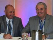 John Hammill (l), CIPH chairman and David Morden, HRAI chairman sign MOU.