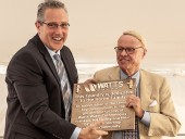 Tyler Stone (l), director of operations presents a commemorative plaque to Timothy Horne, who took over the reins of the company in 1978 until his retirement in 2002. It was under his leadership that the company went public and began the acquisition program that established Watts as an international presence. Photo ImagesPlus Photography