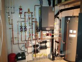 Whitehead submitted an entry detailing the installation of a Knight wall mount boiler and a Squire indirect water heater at a custom home in Calgary, AB (shown here).