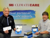 John Gignac (left) founder of the Hawkins-Gignac Foundation with ClimateCare past president Dave Murtland of D&B ClimateCare in Simcoe, ON.
