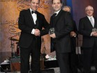 Mario Caissie (r), president of Imperial Manufacturing Group accepts the gold standard award from Frank Vettese, managing partner and chief executive of Deloitte in Canada.