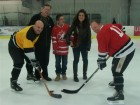 (Left to right) Wolseley employees Bill Hillier, Bill Teabo, Bill Freshwater (far right) on the ice for the ceremonial puck drop by Special Olympian Alex (with his mother). Alex also handed out trophies to the winning team.