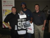 Francis Renee (middle) of Universal Air, won the signed Wayne Gretzky jersey door prize at Noble's 2014 Heating Show, courtesy of Ipex. Renne is flanked by Mike Mercurio (left) of Ipex and Tom Breen of Noble.