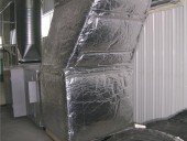Direct fired make up air unit. Insulated intake air in foreground, supply air in background.