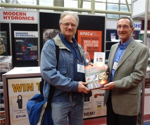 Joseph Sturm (l), winner of the Heating With Renewable Energy draw on March 17 with John Siegenthaler. Sturm is with Smartbuild Inc. in Gravenhurst, ON.
