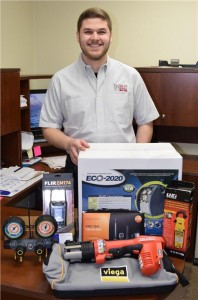 Ryan Moniz of Quality Mechanical Inc. in Mississauga, ON with his Tremendous Tool Take-Away winnings.